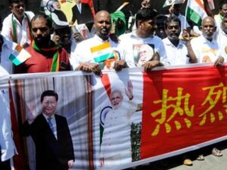 China's president in India for summit amid Kashmir tensions