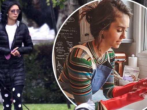 Nina Dobrev takes an isolation break to walk her dog after encouraging fans to be safe amid COVID-19