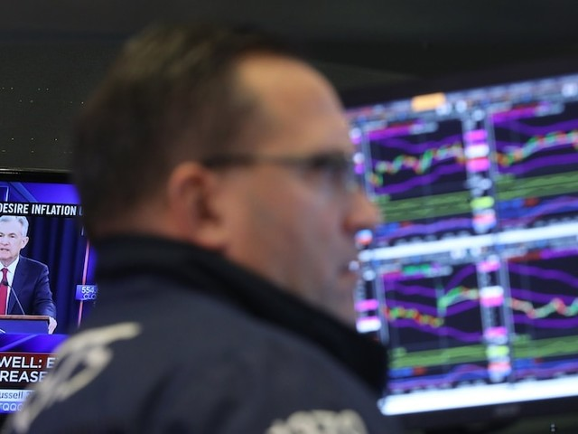 Stocks fall sharply after the Fed's first rate cut in more than 10 years