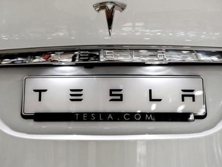 Tesla sacks hundreds of workers on Model 3 stall: source
