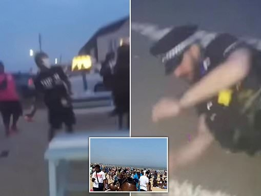 Shocking moment partygoers throw objects at police at illegal 'cookout' rave on Kent beach