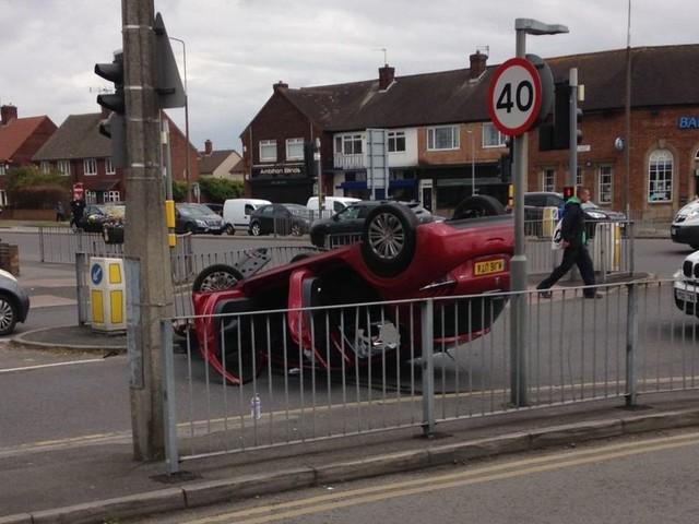 Car on roof after crash in Hunts Cross