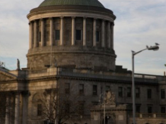 Family suing gardaí after officers wrongly raided their home