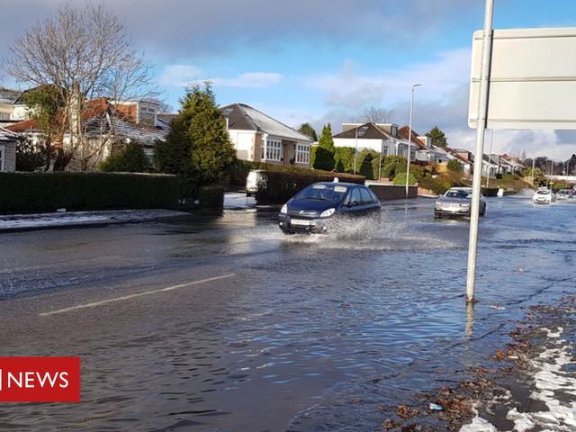 Water supplies restored after Bearsden main floods houses
