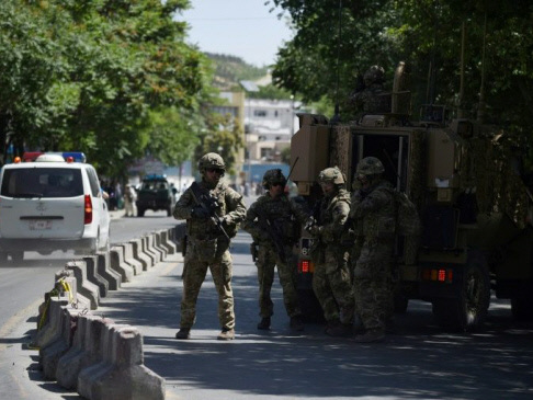 Gunmen kill eight Afghan guards at largest US base