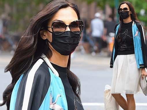 Famke Janssen puts her toned legs on display in a chic chiffon skirt as she runs errands in NYC