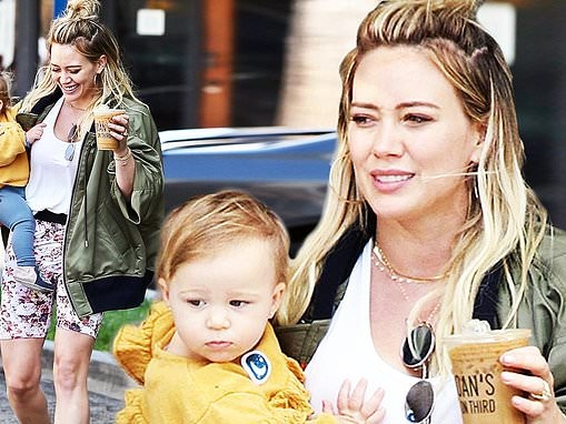 Hilary Duff has her hands full as she carries daughter Banks and an iced coffee