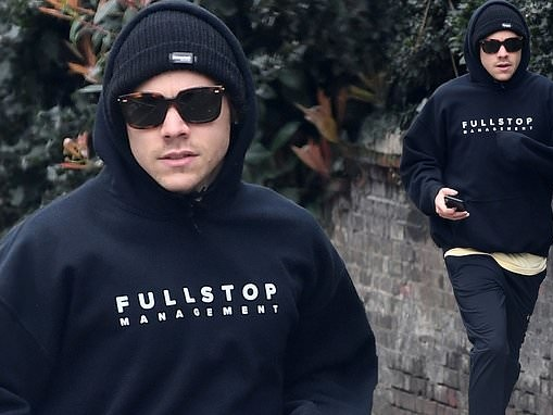 Harry Styles heads out on a jog as he is seen for the first time since the death of Caroline Flack
