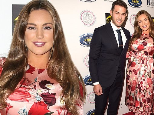 Kelly Brook stuns in a floral dress as she cosies up to beau Jeremy Parisi at charity gala in London