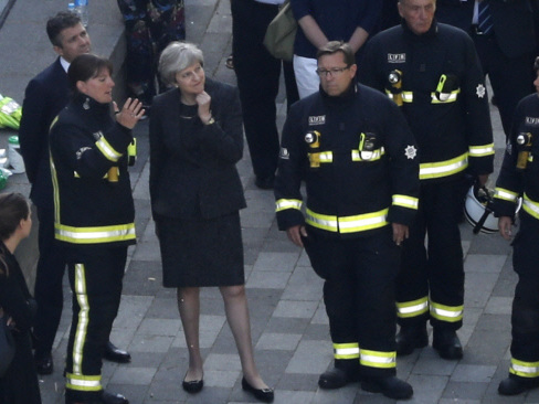 PM orders probe as firefighters search for bodies in London tower