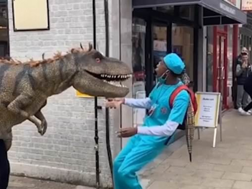 Joker in a T-Rex costume sparks panic on street as terrified pedestrians fall over