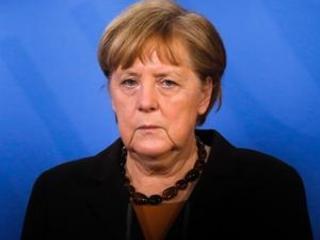 Germany's Merkel: build political majority vs climate change