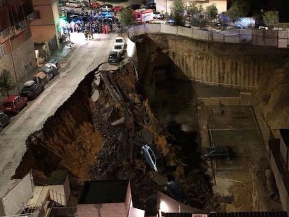 Huge landslip swallows cars and destabilises street in Rome