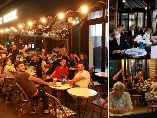 Parisians flock for a drink at midnight as France reopens its beloved cafes and restaurants