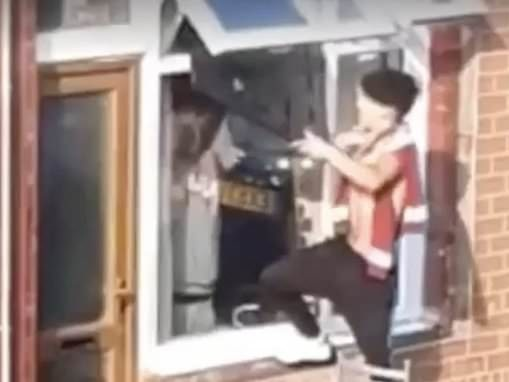 Moment two youths steal TV after breaking into home and passing it through window in under a minute