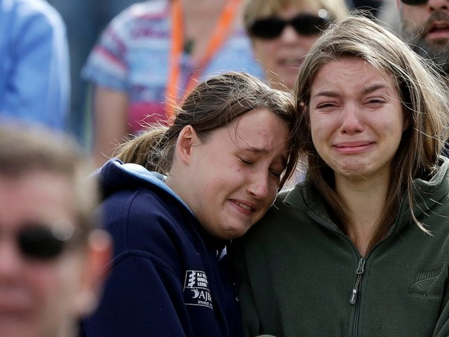 New Zealand shooting survivor says he forgives the gunman, at emotional gathering where 20,000 people heard the names of the victims read aloud