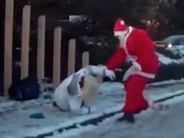 Santa To The Rescue! Dashcam Captures Kris Kringle Helping Woman Who Fell