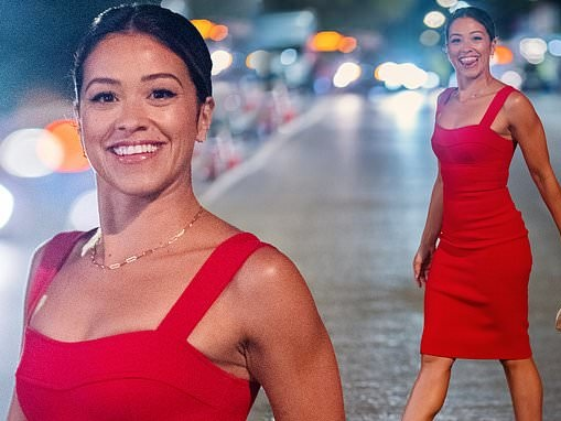 Gina Rodriguez stuns in red pencil dress and heels while filming Players in New York