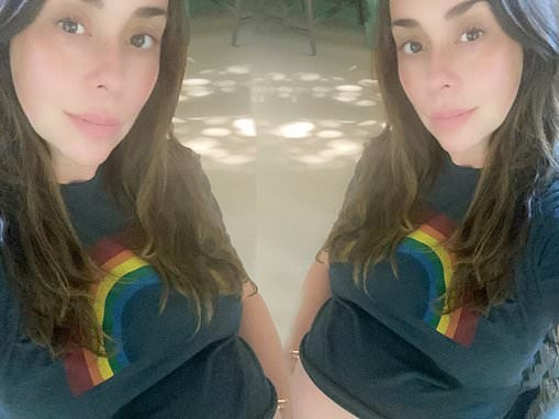 Pregnant Jennifer Love Hewitt flashes her blossoming bump in a rainbow T-shirt