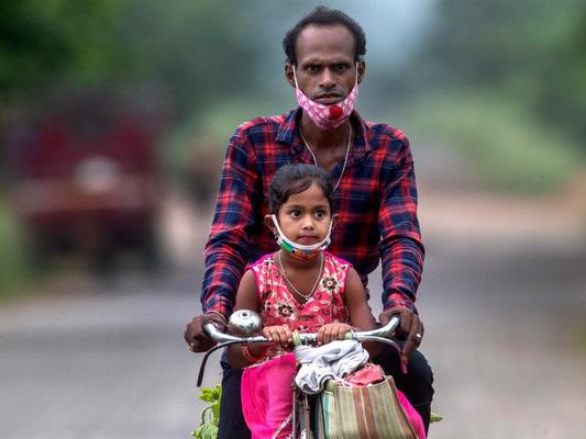 Daily coronavirus cases in India dip below 100,000