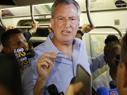 NYC mayor wants tax for the 1 percent to fund subway fix