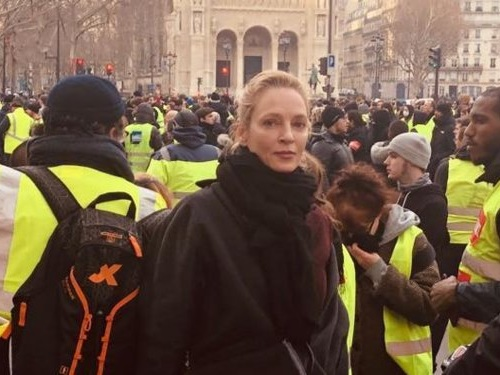 Uma Thurman posts a photo posing with yellow vest protesters in Paris