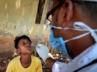 The Latest: India reports drop in cases in Delhi, Mumbai