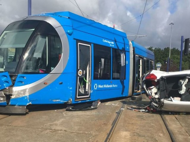 Five injured as car overturns after hitting tram