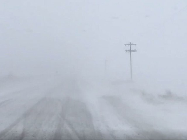Snow blows through Minnesota in 1st winter storm of the season