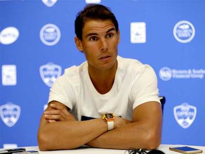 Nadal delighted at return to No. 1, sorry Federer out