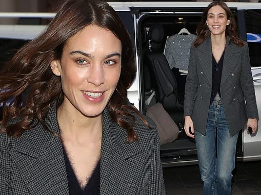 Alexa Chung looks effortlessly chic in a fluffy cardigan as she arrives at radio studios in London