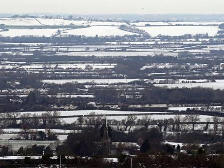 In pics: Black ice and white snow covers parts of the UK
