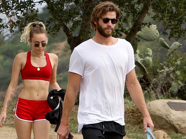 Miley Cyrus Shows Off Her Toned Abs While Hiking With Liam Hemsworth and Their Dogs