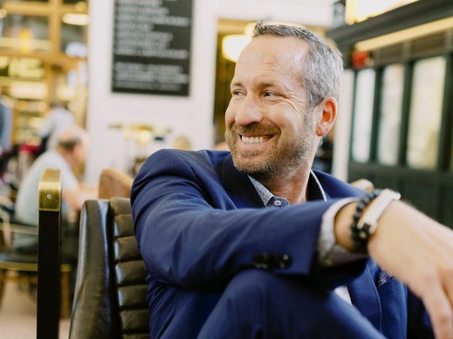 A day in the life of Denver-based Re/max CEO Adam Contos, who wakes up at 4:30 a.m., records a podcast almost every day, and has a morning snack of raw egg whites