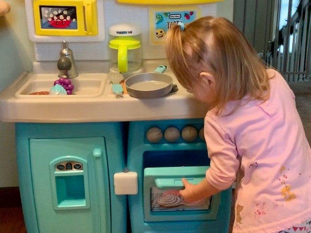 My toddler is learning to play independently with this Little Tikes kitchen — it has an Alexa skill that teaches her how to make pretend meals