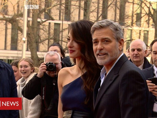 George and Amal Clooney shiver in Scottish spring