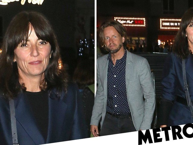 Davina McCall smiles away as she steps out with 'new boyfriend' Michael Douglas after divorce from Matthew Robertson