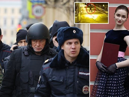 Russian military historian is flanked by police as he retraces his steps from night of murder