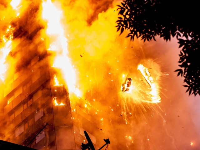 A horrific image of Grenfell Tower in flames could be the most striking news photograph of the year — here's how it was taken