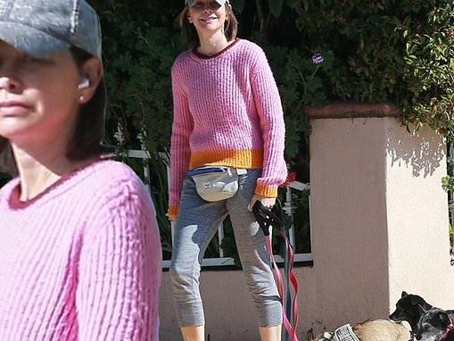 Calista Flockhart walks her three small rescue dogs in Santa Monica amid coronavirus quarantine