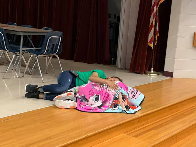 School custodian Esther McCool comforts girl with autism in touching photo