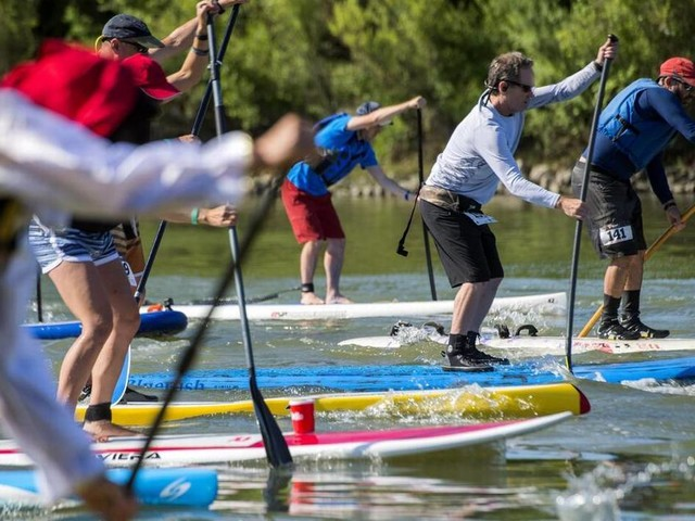Racing paddleboards, raising funds for rescue team
