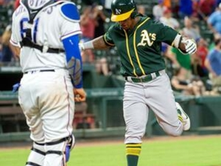 Davis hits 2 more HRs, A's rally again to beat Rangers 6-5