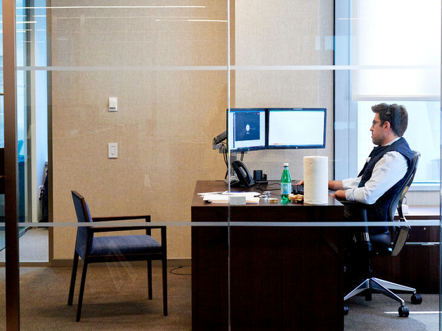 Dust Off Desks and Boot Up Terminals: Wall St. Returns, Fitfully