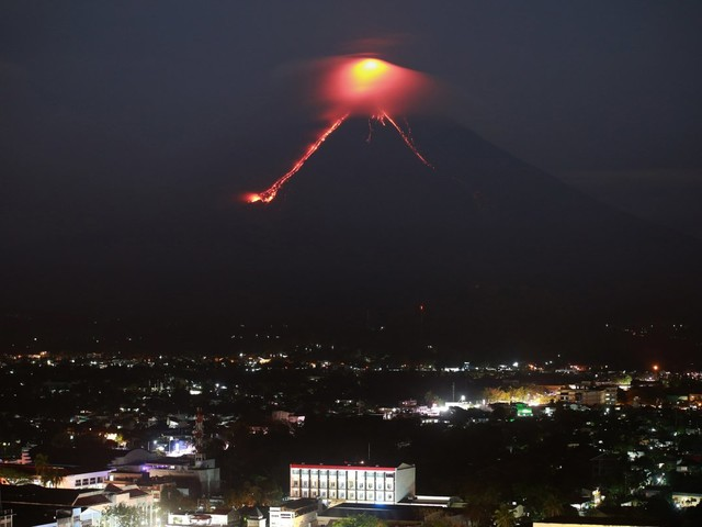 Nearly 15,000 evacuate as lava flows from volcano in the Philippines