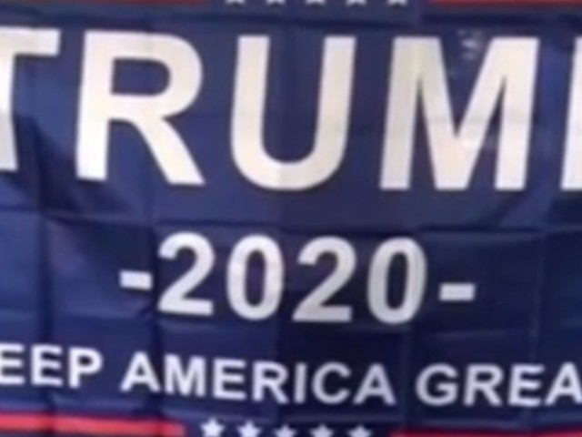 Trump banner held by white fans at HS basketball game angers black coach — so district is investigating