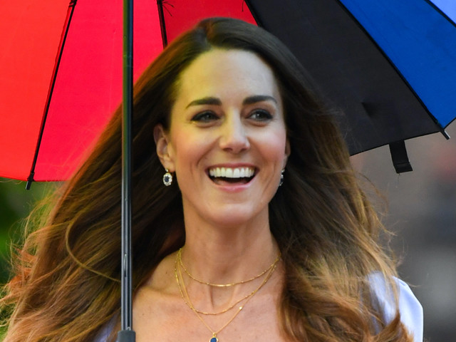 Kate Middleton Brightens Up a Rainy Day in Lavender Dress & Her Favorite Pumps With Rainbow Umbrella