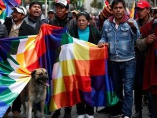 Uncertainty in Bolivia as senator claims interim presidency