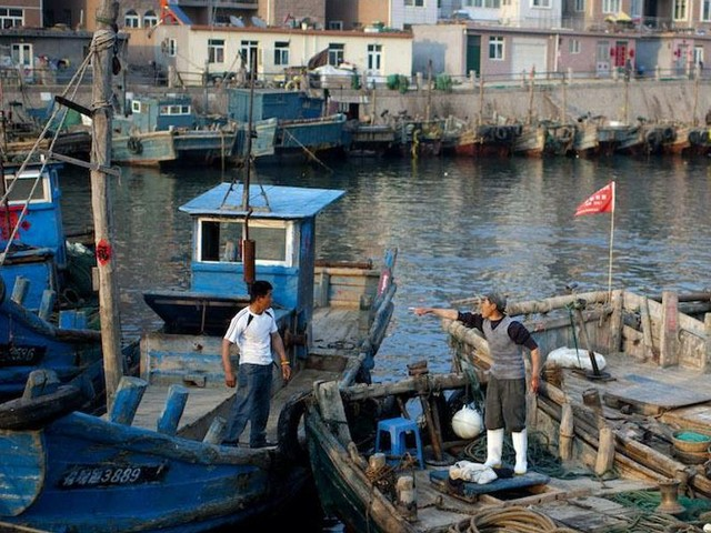 Chinese officials forcibly remove crosses, erase 'Emmanuel' from Christians' fishing boats. Victims say gov't did not do the same to other religions.