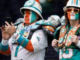 The Latest: Tagovailoa leads Miami against Jaguars in London